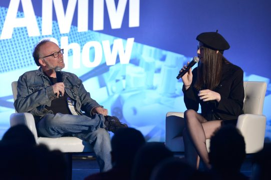 ANAHEIM, CALIFORNIA - JANUARY 18: Steve Baltin and Elise Trouw speak onstage at The 2020 NAMM Show on January 18, 2020 in Anaheim, California. (Photo by Jerod Harris/Getty Images for NAMM)