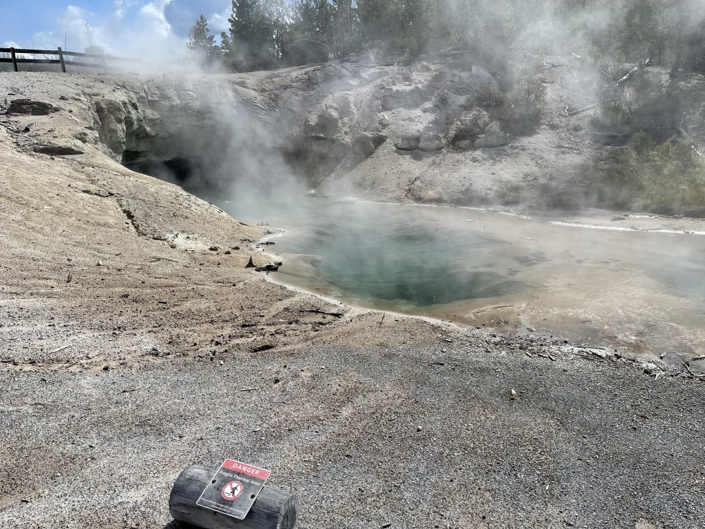 Steamy pool and cave