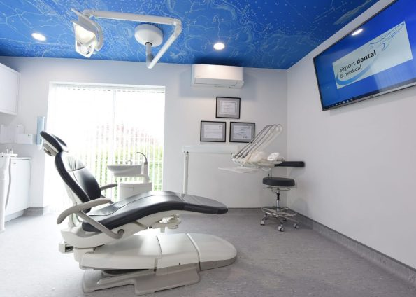 Cork dental surgery design with ceiling mural