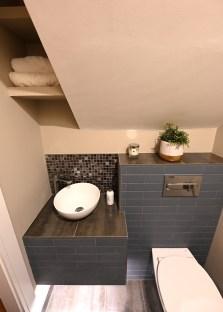 Guest bathroom design with countertop basin