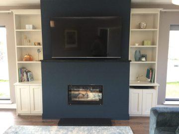 TV/fireplace wall design with bespoke wall units