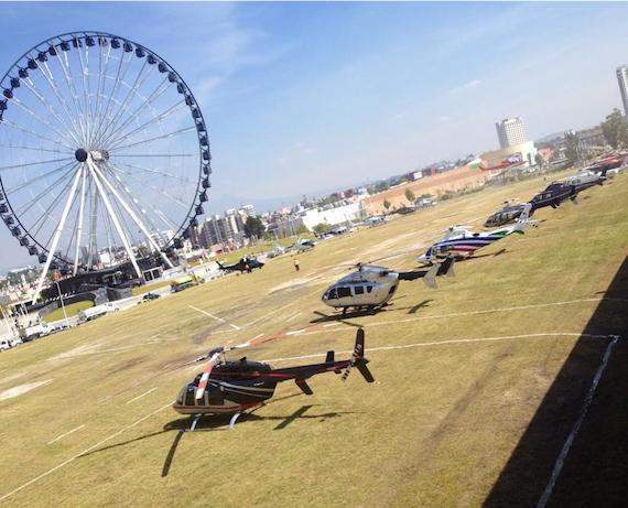 Al menos 16 helicópteros aterrizaron en Puebla para el IV Informe de Gobierno de Moreno Valle. Foto vía Twitter: @rochapress
