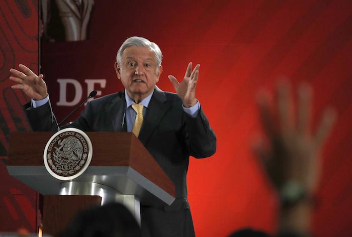 En esta fotografía del viernes 8 de marzo de 2019, el Presidente Andrés Manuel López Obrador responde preguntas en su conferencia de prensa diaria en el Palacio Nacional, en la Ciudad de México.