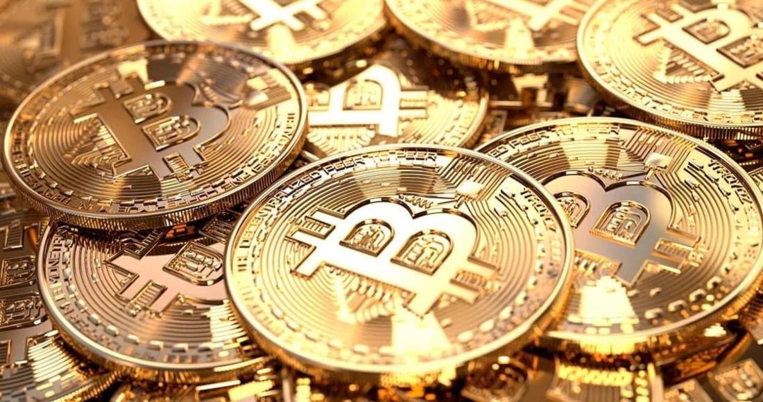monedas doradas bitcoin - Inversores institucionales ven al bitcoin como refugio a inflación y se acerca a los 42 mil dólares