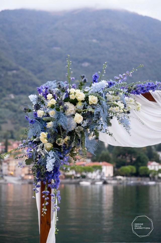 Wedding arch on Como lake, with blue floral decor