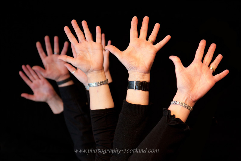 Outspread hands on a black background