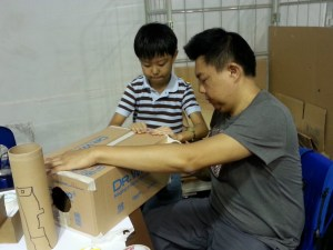 Father and Son thinking of ways to Make a different Vortex Cannon.