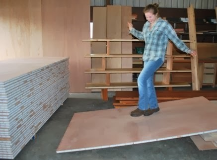 Woman demonstrates lighwtweight strong torsion box foam