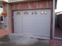 garage door with man door  Non-warping patented wooden ...