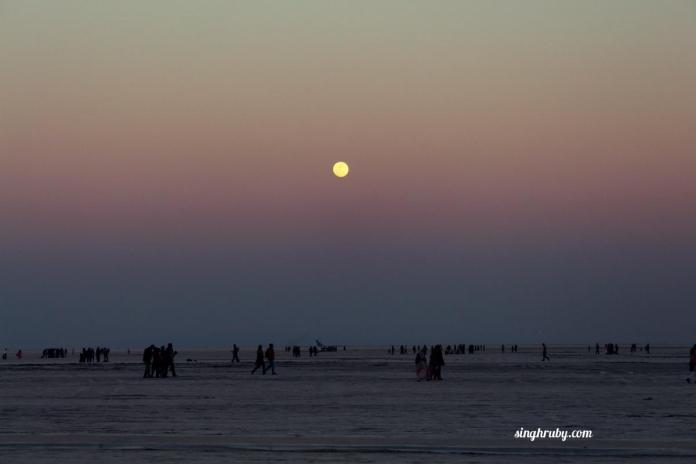 The sun goes down and the moon comes up at Rann of Kutch