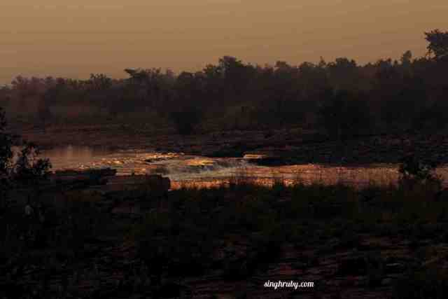 gleaming-stream-of-water-under-the-sunset
