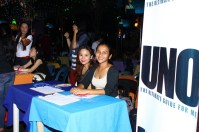 Marcie Linao and Donna Fuentes at the registration booth greeted guests and handed complimentary copies of the special edition UNO Magazine.