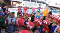 Race Director and Coach, Ani de Leon-Brown briefs Ironkids participants about the race rules and routes.