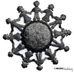 Children of the World, metal art from Haiti.