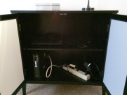 The cabinet by the entry way, is hiding/storing the wifi unit and other electronics