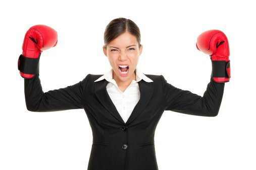 Boxing gloves business woman angry