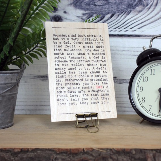 Wooden Father's Day Plaque standing on a wooden shelf next to a clock.