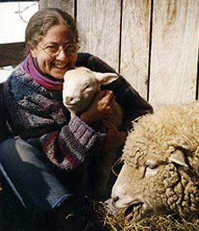 Carol Holding Lamb with Mother Looking On