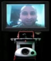 Fred Nikogar of RoboDynamics onscreen his tele-presence robot