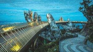 solarpunk stone hands golden bridge vietnam dusk trees