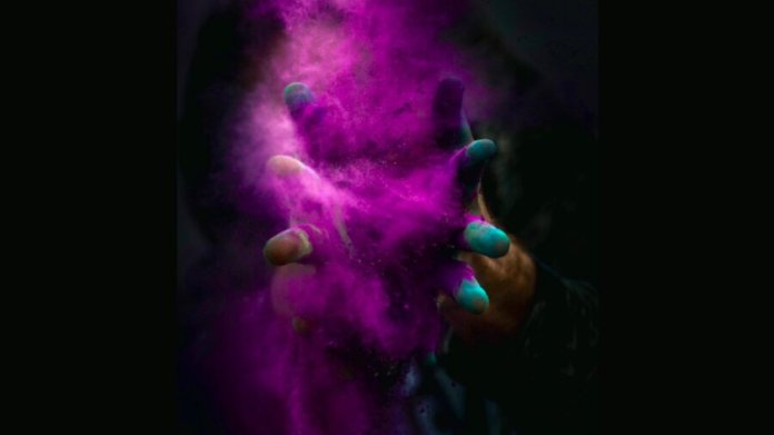 tech stories hands purple powder explosion black background enhanced