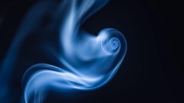 tech stories blue smoke swirl black background
