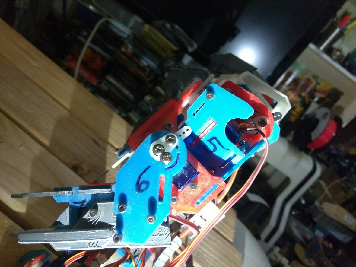 Reinforcing my new Raspberry Pi robot so the shoulders and elbows don't rattle.