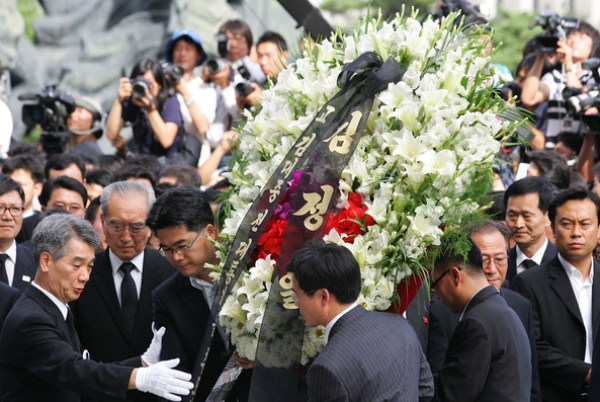 North Korean senior KWP official Kim Ki-Nam with other officials from the North offer flowers at Kim Dae-jung's funeral | Chung Sung-Jun/Getty Images AsiaPac