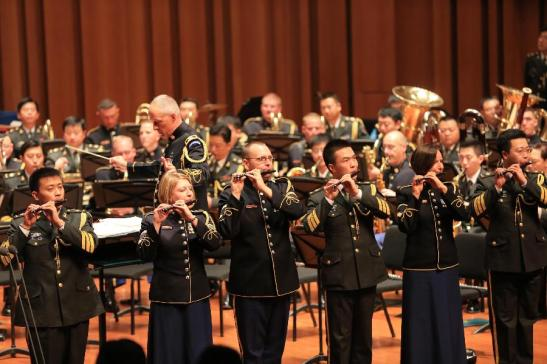 North Korea driving US and China to play from the same sheet of music?  The U.S. Army band and the PLA band in concert together.  Photo via Xinhua