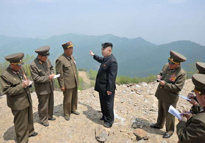 Kim doling out onsite guidance at Masik Pass Ski Resort construction site | image Rodong Sinmun, May 27, 2013