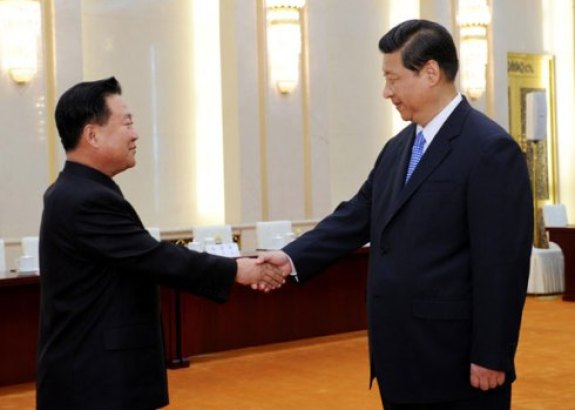 Stiff-armed handshake: Choe Ryong-hae meets Xi Jinping in his civilian clothes | Image: Xinhua