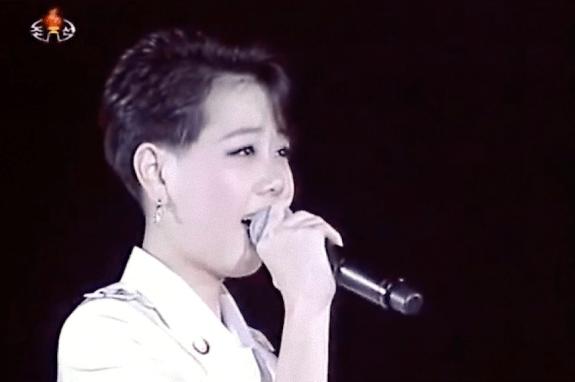 The original female version of the Kim Jong-un haircut; Kim Yu-kyong. | Image: Moranbong Band concert 10 October 2012/Youtube.