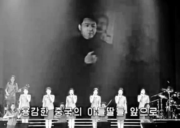 A rare juxtaposition of Kim Il-song during the Korean War, and his mentor Stalin. Image via Moranbong Band/Chosun Central TV.