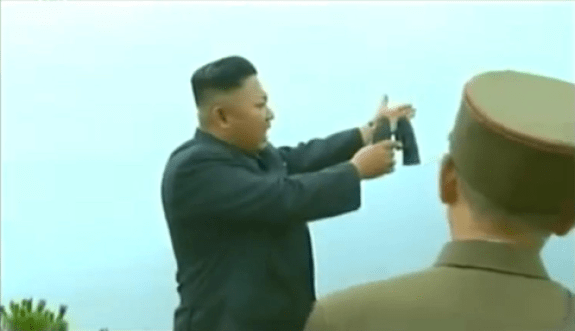Kim Jong-un voices off during military exercises in spring 2014. Image via Chosun Central Television