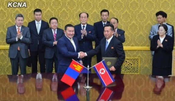 As explained by North Korea Leadership Watch: Mongolian Minister of Industry and Agriculture Khaltmaa Battulga (L) shakes hands with DPRK Minister of Foreign Trade Ri Ryong Nam (R) after signing an economic cooperation agreement at Mansudae Assembly Hall in Pyongyang on 28 October 2013. | Image: KCNA