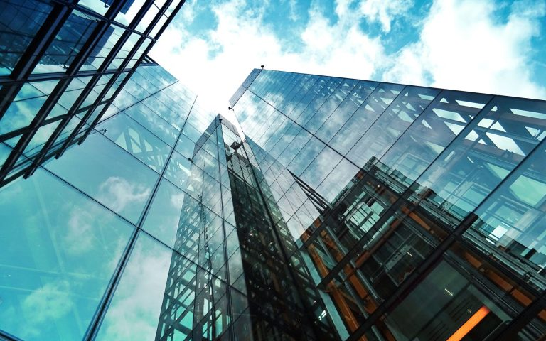 tall glass building with sky in background