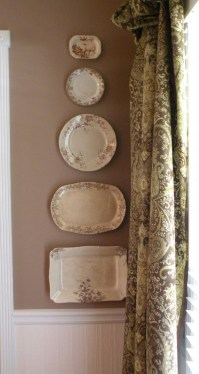 A mixture of old plates, similar in colour blend well with rooms decor
