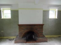 Before - The sitting room with the original 1930's brick fireplace.