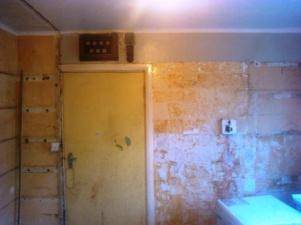 Kitchen with tiles stripped off.