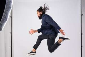 A london branding photoshoot with a man jumping in mid air in a london headshots photograph