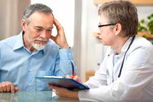 man speaking with physician