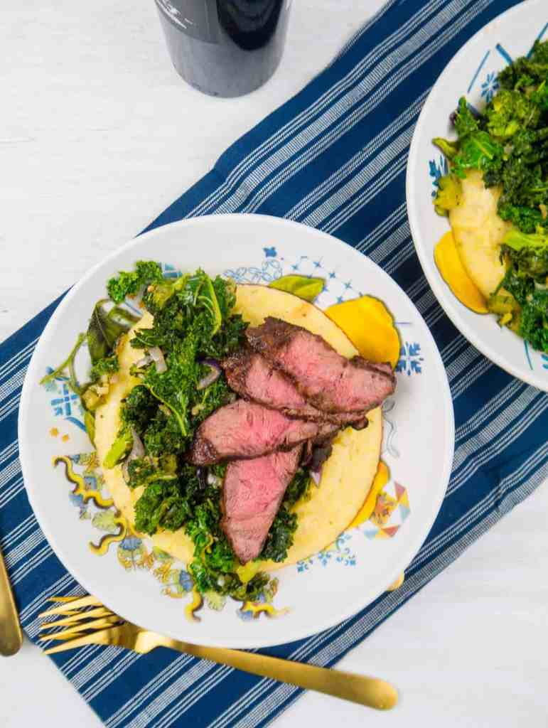 Cheesy Polenta with Grilled Steak and Garlicky Greens | Sip + Spice