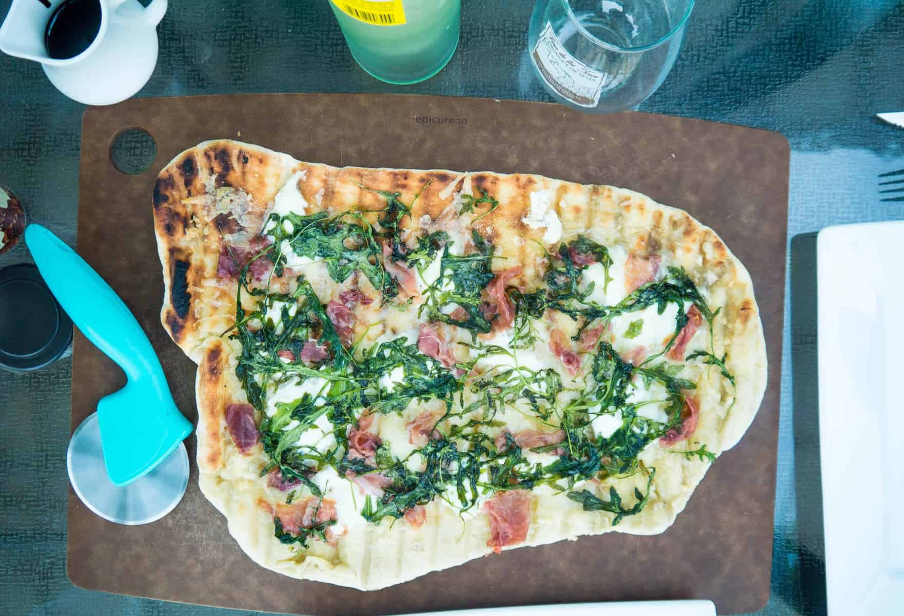 Grilled Prosciutto and Garlic Ricotta Pizza with Arugula and Balsamic Glaze