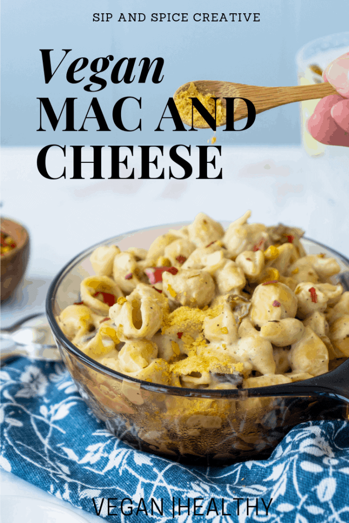 The creamiest, most decadent vegan mac and cheese you've ever had! This Healthy Vegan Mac and Cheese is made with cauliflower and cashew sauce and features tiny roasted veggie gems throughout. | Sip and Spice #healthydinner #summerrecipes #vegandinner #veganmacandcheese