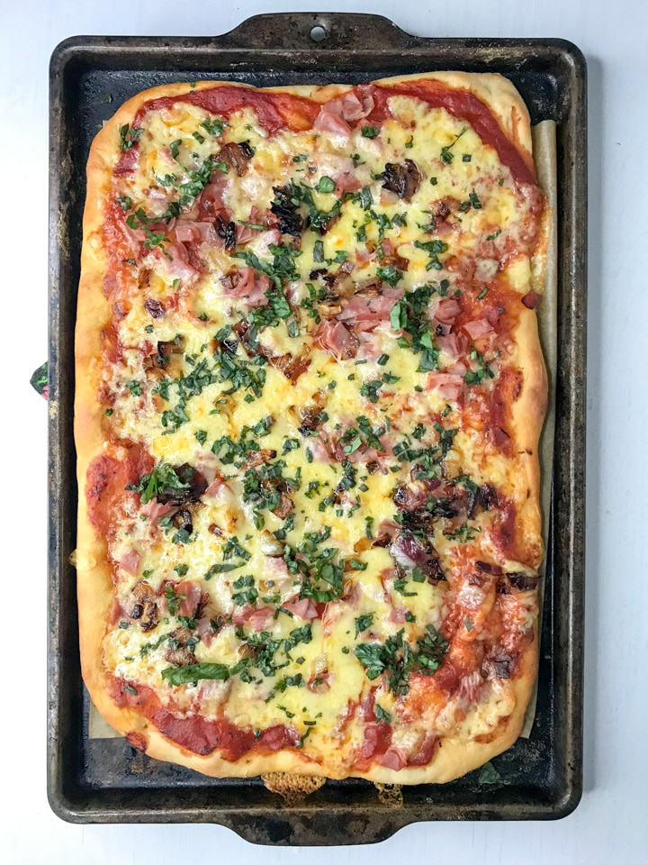 pizza cooling on a baking sheet