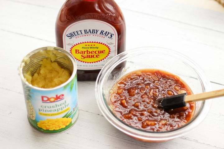 bowl of sauce made with dole crushed pineapples and bbq sauce on a white table