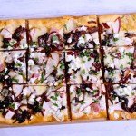 Pear and goat cheese flatbread with caramelized onions and ham