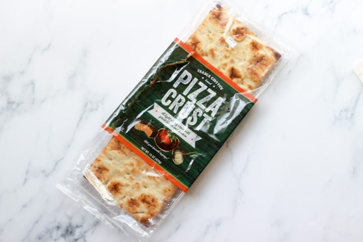 trader joe's pre baked pizza crust on a kitchen counter