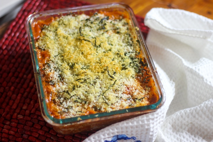 baked chicken parmesan with vodka sauce with panko crumbs on a dinner table