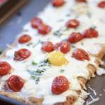 breakfast pizza with eggs baked in the oven